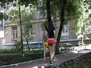 Outdoor shorts wetting by 2 sexy girls