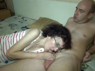 This dude has the most good from two very different generations. A young whore and a granny are sucking his hard cock. It's seems that sex has nothing to do with age as those whores are competing in who sucks it better...