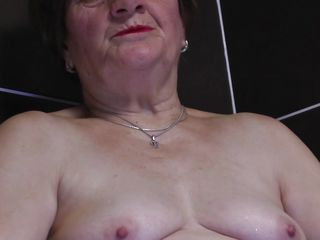 Watch this horny 70 years old lady masturbating all alone while taking a bath. This babe is all naked, showing her chubby body and saggy tits. And in the tub water this horny granny starts touching herself like a horny..