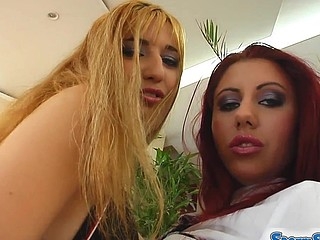 A super hawt blond and a cute redhead are willing to share a load. After a session of intense love tunnel pounding the 2 horny whores exchange the jizz from one to some other.
