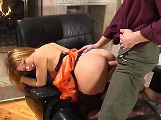 Cute gal in fancy nylons launching into fucking frenzy by the fire-place