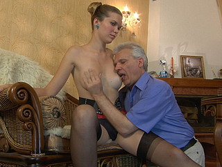 Bitchy angel in red-n-black attire using a horny old gent as her fuck toy