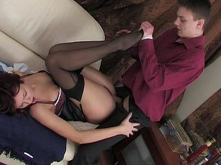 Black-stockinged office cutie puts off her notes for a quickie with her boss