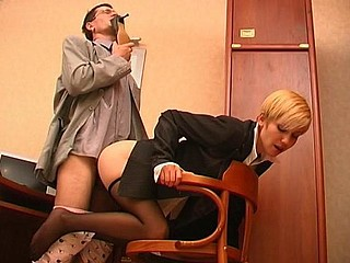 Lewd co-worker sniffing high heel shoes whilst fucking hot gal in dark hose