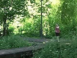 Slut pisses actively from a park bridge