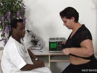 During her regular breast check-up, Chyntia decided to accept her doctor's sexual advances this time! The black physician deliberately fondled her big tits which moved down below to shove his dark fingers in her..