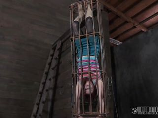What do we have here? It's a redhead cunt in a small cage and she awaits her punishment. This worthless slut is about to receive an humiliating punishment, just the way she deserves it. See how the executor takes off the..
