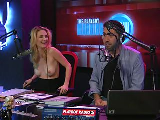 Playboy Radio has a morning show and one of the DJ's is a model named Andrea Lowell. She does the Lowell Report, where she takes her top off and reports on news stories from around the world. Her and her partner discuss..