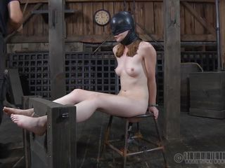 The pale slut wears a black mask and sucks this guy with lust, literally swallowing his dick. Giving a hot head was the easy part because now she patiently awaits on that chair with her legs secured in a thraldom device...