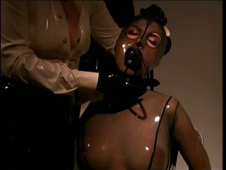 Thrall Girl Wrapped In Skintight Latex