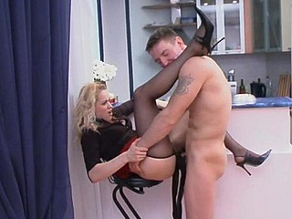 Golden-Haired mistress in black hose admired and gratified by her nylon mad sub