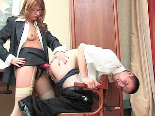 Strap-on armed secretary probing and poking guy