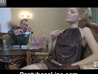 Dolled-up gal in a cocktail gown and crotchless hose enjoys after-party sex