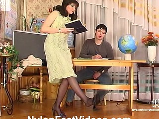 Sweltering female teacher giving hawt student some lessons of nylon fucking