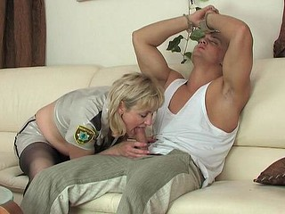 Aged officer in dark hose handcuffs a guy for 69ing and weenie-riding