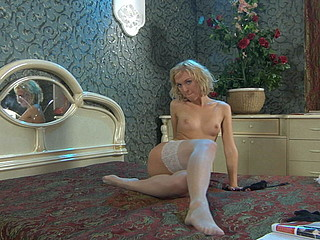 Outrageously sexy chick changing several times her expensive nylon nylons