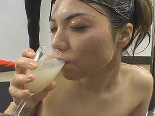 Erika Ando gets cum all over her face and body  collects cum in a glass and drinks it after.