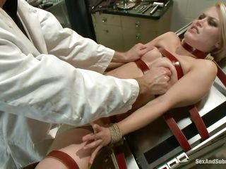 It's a hard exam for Ash's pussy, she's tied with red leather belts on the gynecologist table and her doc performs a hard fisting before taking out his cock and fuck her deep. She groans with pleasure as his hand goes..