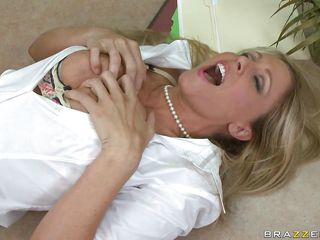 Julia Ann is doing a presentation and is getting buzzed by Xander via remote control vibrator. Every time this guy pushes the button, her button gets pushed, making her writhe on the table, getting her tits out. The..