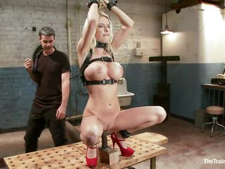 Golden-haired and with a pair of large round boobs, Riley is the perfect subject for a hard punishment. She's locked in a cell and the executor tied her hands and filled her pussy with a dildo. If she lowers her cunt..