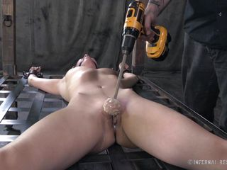 Casey has a superb fit body, she is naked and tied on that grill, waiting her punishment. They've ball gagged her and began the punishment. She stays there as her pussy is rubbed hard with that drill and then with a..