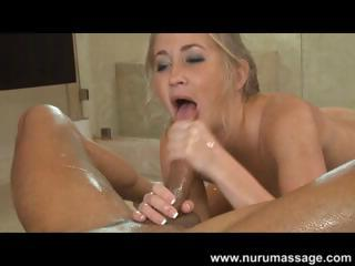 Blonde Mandy Armani is giving this guy a Nuru massage and blows him