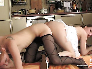 Youthful leggy redhead licking and stuffing a double fake weenie with a lez aged