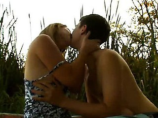 Pretty and naughty girl has fun with handsome dude outdoors