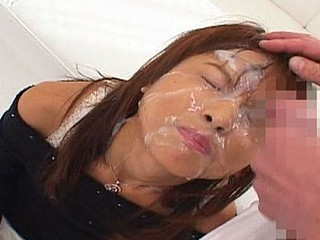 Akira Shiratori gave out blowjobs and guys take turn cumming all over her face and on her mounds.
