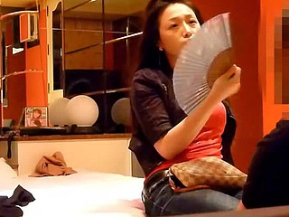 The private sex tape of this Oriental couple introduces 'em talking, smoking and taking pictures of themselves while sitting on the bed. Soon, they get horny and the cutie gives the guy a blowjob.