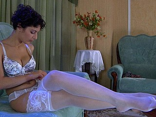 Bobbed brunette hair lovingly smoothing her luscious white lace top nylons