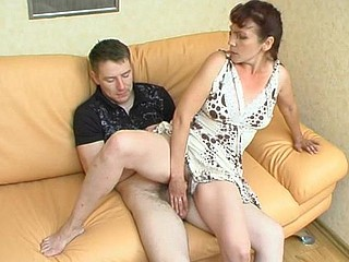 Sultry older gal is very admirable in luring younger guy into steamy fucking