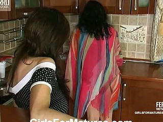Chubby mamma seducing well-shaped hottie into wild sex-toy-action in the kitchen