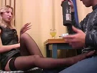 Stella looks damn fine in her leather suit and her sexy black nylons and as the scene begins this babe has her foot in Boris' lap and that babe's massaging his manhood. This Chab pours her a glass of wine and they start..