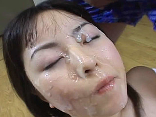 Manami Yoshii receives cumshots  plays with cum and swallows it.