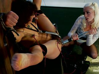 The blonde milf is enjoying every pont of time of fucking this brunette slut. She inserted a metal hook in her hairy vagina and now plays with her tight anus making her moan with pleasure. The brunette is tied and has..