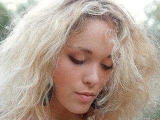 Juvenile beautiful blondie posing