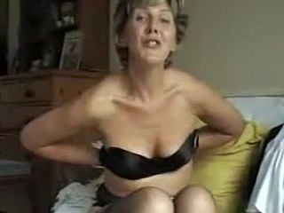 This 50-something mommy takes off her bra and shows us her tits, squeezing them, profiling them, lifting them and playing with her nipples.