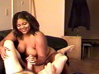 This BBW black chick gives head and a handjob to a white guy.  That babe seems to be talking a lot but there is not any audio so you don't know what she is saying.  Good video quality.