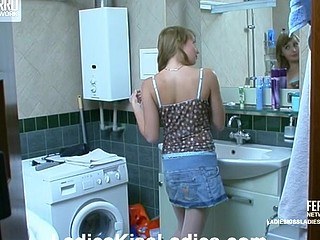 2 naughty coeds practicing lesbo love giving a kiss and fondling in a bath