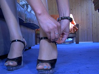 Nasty beauty readily showcasing her nyloned feet in spike heel sandals