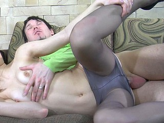 Stunning honey wearing shiny grey pantyhose going down for steamy shagging