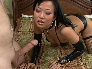 Exotic Asian mistress Niya Yu mixes leather and lace to get her fellow rock hard.  This Hottie expertly sucks him off, jacking him off with her diminutive hands and the right amount of suction.  That Hottie takes his cum..