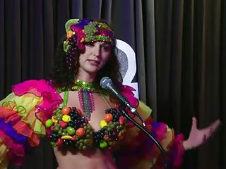 The hosts of Playboy Radio's Morning Show are looking at their guest model who is wearing the costume she'll be wearing to the Playboy Mansion for Halloween. Her head and tits are overspread in fake fruit like oranges,..