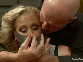 Mature blond Julia needs to learn something about obedience. Here she is in the kitchen, cooking the meal when a muscled bald chap grabs her and ties the bitch with duct tape, throat folding her too. This guy puts the..