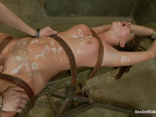 Submissive vagina Rilynn enjoys being waxed and fucked in that taut soaked pussy of hers at the same time. She has her hand tied up and her legs widen for a total domination from Xander. The executor sticks a vibrator on..