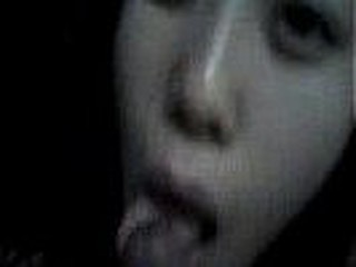 Grainy but very lifelike leaked private clip of a Korean GF blowing a firm cock kneeling in an unlit room and occasionally checking out her lovers face for signs of pleasure.