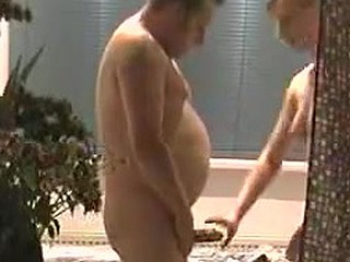 Older pair enjoy their classic fuck in the bath with a little twist of the camera. It films them as he fucks her doggy style and jizzes in her mouth. Nothing out of the ordinary except the filming!
