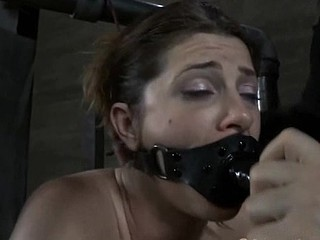 Clamped hottie gets her fuck holes pounded with toys