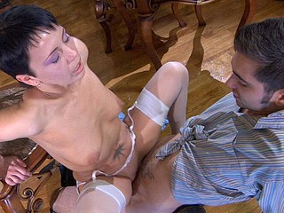 Fiery gal in white shiny nylons talks a guy into joining her for a fuck